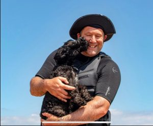 even the fur baby enjoys daddy kite surfing